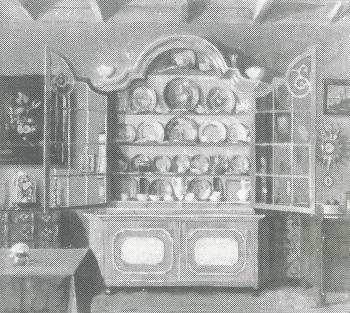 De glazenkast (ca. 1940) door Lucie van Dam van Isselt